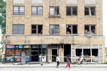 A burned down liquor store is seen after disturbances following the police shooting of a man in Milwaukee, Wisconsin